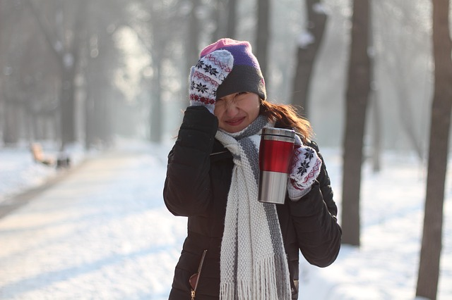 woman with hot tea in snow
