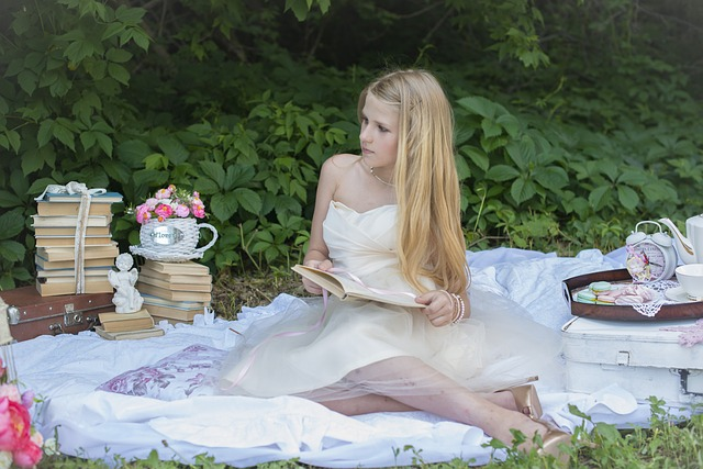 girl tea party in white dress reading a book